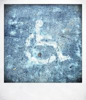 Faded Handicapped Parking Sign by wiebkefesch