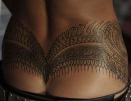 Fancy tramp stamp by strangeris