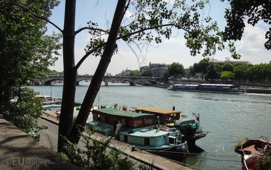 View through trees to the Seine by EUtouring