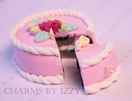 Huge cake and slice pink and white icing by CharmsByIzzy