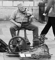 The Fiddler... by EarthHart