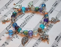 Blue and purple stretchy bracelet with charms by TerraNovaJewels