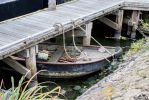 Metal Rowboat With Fishing Equipment And Dock by SIG442