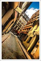 a narrow street by eugenes