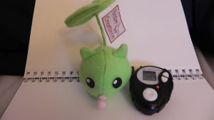 Leafmon Plush and Black d3 digivice by Raded-Raikage