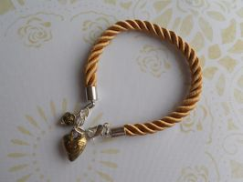 Bracelet with pendants - heart and flower by SteamJo