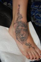 lionhead and swirls by Kiddotattoo
