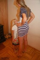 Tall girl looking down at short girl by lowerrider