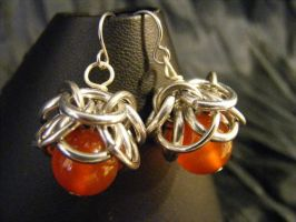 carnelian helmcap earrings by BacktoEarthCreations