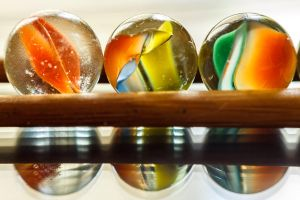 Marbles on a stick by sztewe