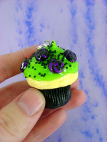 Toxic Candy Swirl Cupcake by monsterkookies