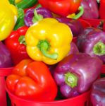 Yellow, Red and Purple Bell Peppers by Kitteh-Pawz