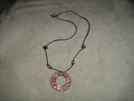 Bronze circle necklace by moordred-fangirl