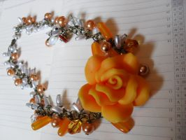 Orange beads in necklace with flower by edelweiss-workshop