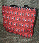 Deadpool logo tote bag by GoupyCat