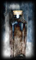 Spooky old bottle by coldkisses