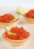 Tartlets with red caviar and lime by BeKaphoto