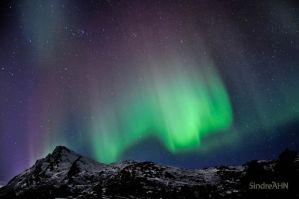 Auroras above Mjelle-Peak 2 by SindreAHN