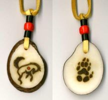 """Wolf Dance"" tagua pendant by Foxfeather248"