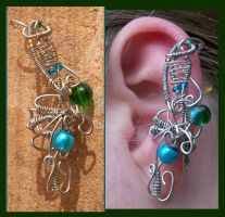 Fearless Peacock Ear Cuff by balthasarcraft