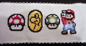 Embroidered Yoshi coin, 1 Up mushroom and Mario by Francoise-Evelyne