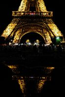 Eiffel Tower with reflection at night by artamusica