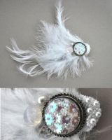 white feather hair fascinator by JozzyKane