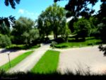 Tiny cyclist riding in the blurred park -tiltshift by Cloudwhisperer67
