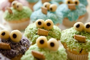 Army of Cookie Monster Cupcakes by reap