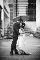 Kissing in the rain. by triciavictoria