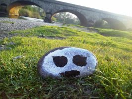 Face Pebble  Left By river by BakersArt86