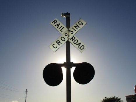 Railroad Crossing Signal in the Afternoon Sun by 2001-ACsiren
