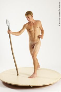 Nude male holding spear by ArtistReferences