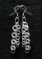 twisted silver earrings by mailledragon