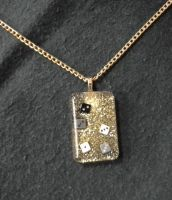Glitter resin pendant with embedded dice by BlackUnicornWood
