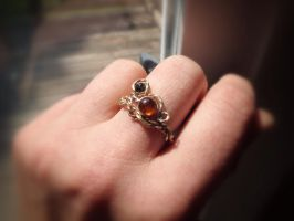 Twisted bronze ring with Amber and Spinel by whippetgirl