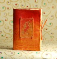 Bright Orange Unicorn Journal by gildbookbinders