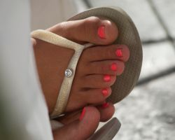 Pink Toes in Flip Flops Close Up by Feetatjoes