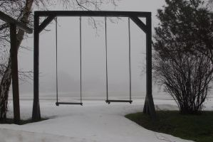 Lonely swings in the fog by magicsnowflake