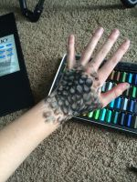 Scales on my hand by SnapDragonStudios