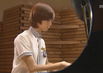 Taeminnie on the piano by MidnightMadness11