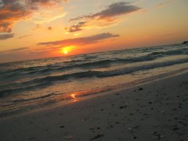 Ocean eating the sun in Florida by TwiztidChevy