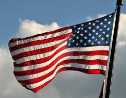 American Flag Flapping in Wind by houstonryan