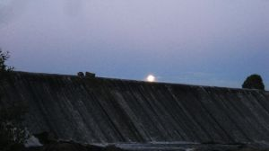 Supermoon over dam (1/15) by outolumo