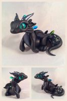 Black on black dice dragon  by HereThereBeSculpture