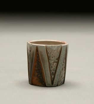 Small cup with triangles by blacklilyfae