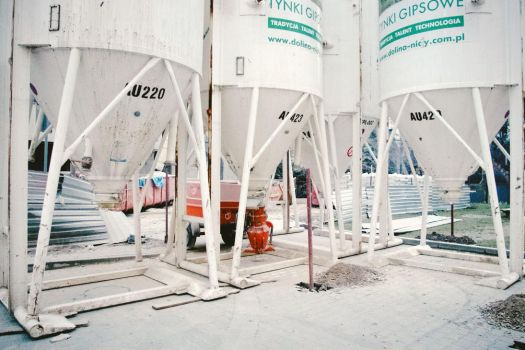 one with white silos and something red by Maclunar