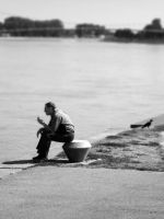 Man on a river bank by Ph1at1ine