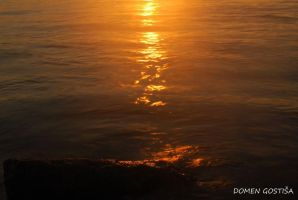 Sunset in the sea by 2DoMeN2