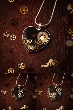 Steampunk Heart necklaces by FrozenNote